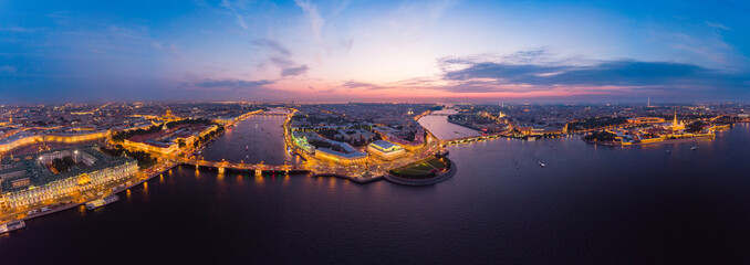 Fotobehang Aubergine Beautiful aerial evning view in the white nights of St. Petersburg, Russia, The Vasilievskiy Island at sunset, Rostral Columns, Admiralty, Palace Bridge, Stock Exchange Building. shot from drone.