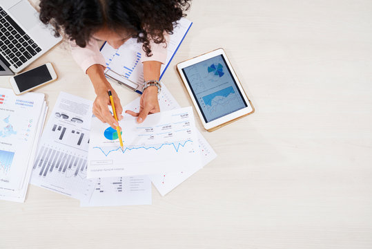 Entrepreneur analyzing charts and diagrams