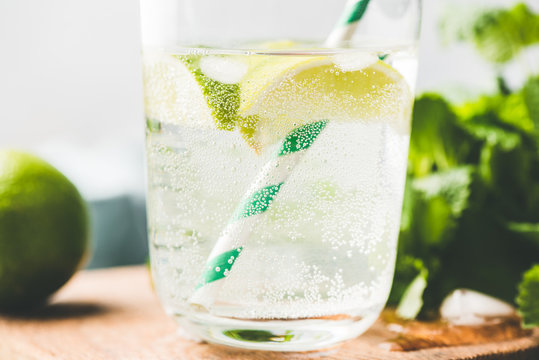 Closeup view of sparkling lemonade in glass, cold summer drink