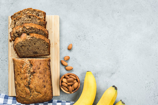 Healthy paleo banana bread loaf on grey concrete background. Table top view
