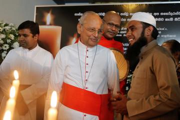 The Archbishop of Colombo, Cardinal Malcom Ranjith, Venerable Kirinde Assaji Thero and Muslim leader Mowlavi Nusrath Nowfal attend a vigil in Colombo