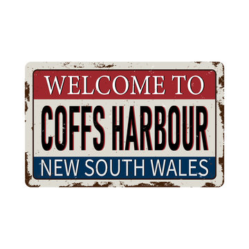 welcome to Coffs Harbour sydney australia rusty plaque sign