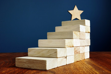 Goal setting and achievement. Star and stairs from wood.