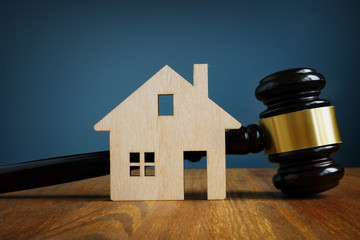 Model of house and gavel. Real estate law concept.