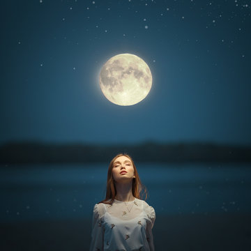 Portrait of a young attractive girl in the light of the moon.