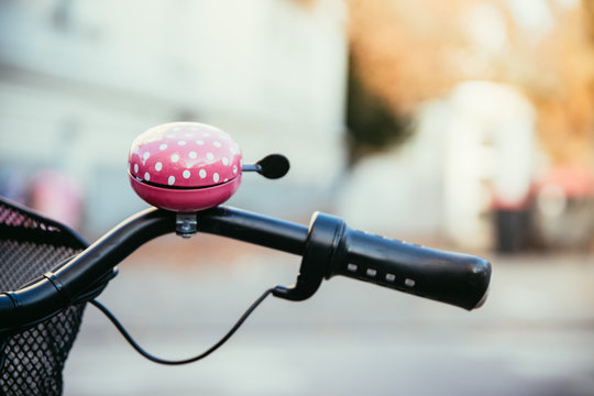 Pink bike bell, urban city, lifestyle