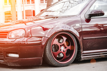 Custom brown forged wheels on a low tuned stance car who stays on a street. dirty Lowrider on a air...