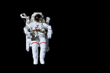 Astronaut with a jetpack isolated on black background with copy space -  Elements of this image are furnished by NASA