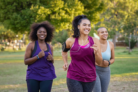 Active curvy women jogging