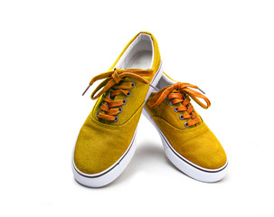 A pair of yellow color canvas shoes isolated on white