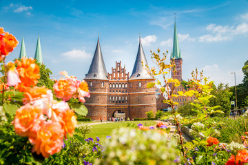 Fototapete - Historic town of Lübeck with famous Holstentor gate in summer, Schleswig-Holstein, northern Germany