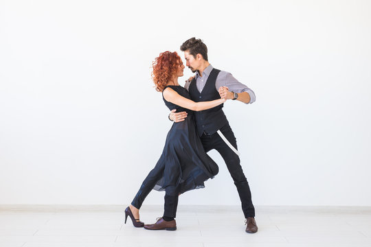 Social dance, kizomba, tango, salsa, people concept - beautiful couple dancing bachata on white background with copy space