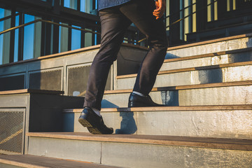 Businessman legs walking up the stairs Fototapete
