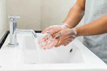 Man washing hands with soap.
