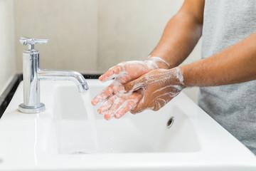 Obraz Man washing hands with soap. - fototapety do salonu
