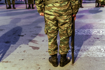 Thessaloniki, Greece Greek Army soldier in combat uniform, holding a G3A4 rifle. Silhouette of a Hellenic Armed forces male standing still, wearing Combat Uniform in a Camouflage Pattern.