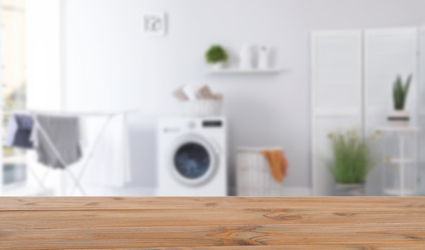 Laundry room interior with washing machine near wall