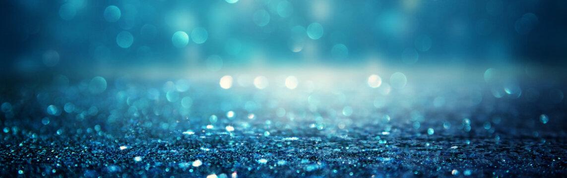 glitter vintage lights background. black and blue. de-focused