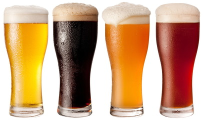 Four glasses with different beers
