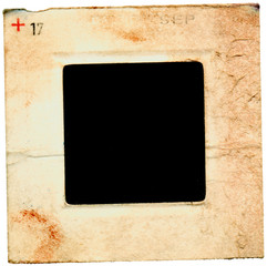 grungy battered old photographic slide with cardboard frame, free space for pics and copy, isolated on white