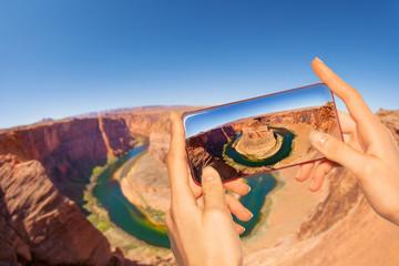 Taking photo of canyon horse shoe in USA Utah