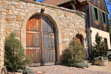 Old Grunge countryside wood door and sandstone wall