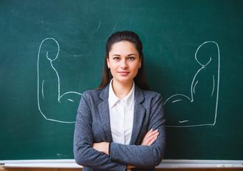 a serious teacher near the board
