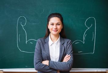 Obraz smiling teacher near the board - fototapety do salonu