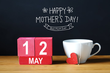 Happy Mothers Day 12 May message with coffee cup with wooden blocks