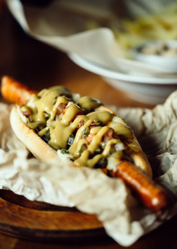 Close-up of tasty Hot Dog with mustard and extra long sausage