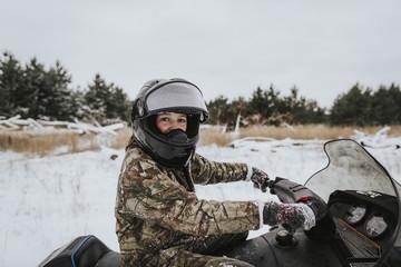 Girl on snowmobile in Northwestern Wisconsin