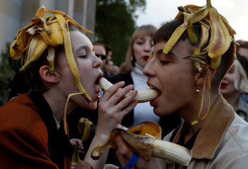 People eat bananas during a protest against perceived censorship by Poland's National Museum in front of the National Museum in Warsaw