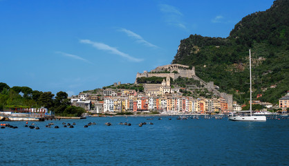 Portovenere town harbour, seafront, church and castle, visited and appreciated by tourists from around the world. Liguria, Italy, the Gulf of Poets.
