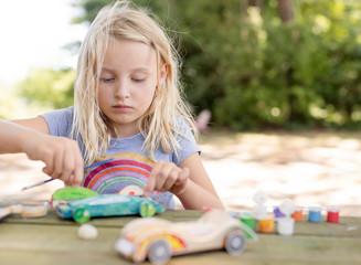 Girl painting a race car