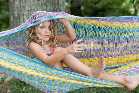 young girl enjoying summer in a hammock