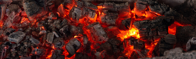 Tuinposter Brandhout textuur Burning coals from a fire abstract background.