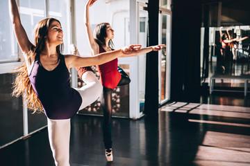 Young ballerinas dancing expressively