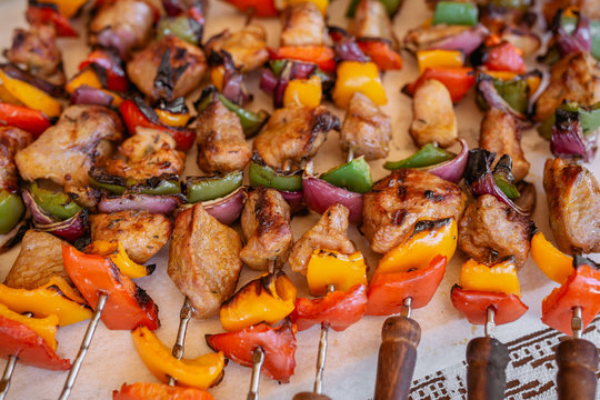 top view of plate with skewers sticks of pork with vegetables from barbeque