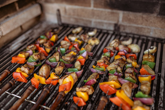 cooking skewers in barbecue