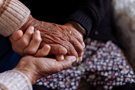 Detail of the wrinkled hands of an elderly couple