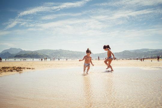 little girls by the seashore
