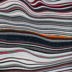 """Fordite, also known as Motor or Detroit Agate, is a unique automotive enamel material with an interesting history. The original layered automotive paint slag """"rough"""" was made incidentally, years ago, by the now extinct practice of hand spray-painting multiples of production cars in big automotive factories. The overprinted paint in the painting bays gradually built up on the tracks and skids that the car frames were painted on. Over time, many colorful layers built up there. These layers were hardened repeatedly in the ovens that the car bodies went into to cure the paint. Some of these deeper layers were even baked 100 times. Eventually, the paint build-up would become obstructing, or too thick and heavy, and had to be removed. As the story goes, some crafty workers with an eye for beauty realized that this unique byproduct was worth salvaging. It was super-cured, patterned like psychedelic agate, and could be cut and polished with relative ease!"""