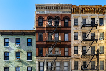 Fotobehang New York Block of colorful old buildings with clear blue sky background in the Upper East Side of Manhattan New York City