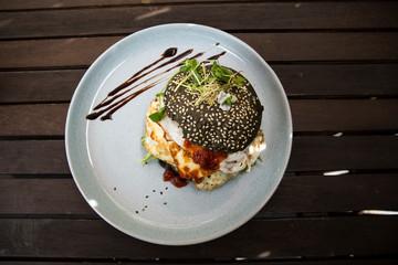 Halloumi burger with black charcoal bun