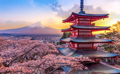 Fujiyoshida, Japan Beautiful view of mountain Fuji and Chureito pagoda at sunset, japan in the spring with cherry blossoms Wall mural