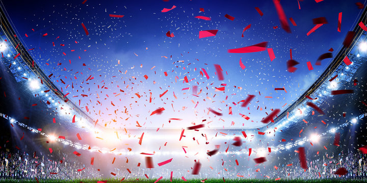 Football stadium background with flying confetti