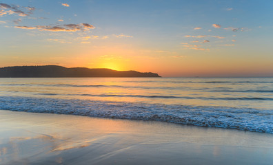 Sunrise Rising Over the Headland Seascape