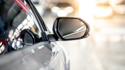 Close up of metallic wing mirror of modern car. Auto transport or automobile industry concepts Wall mural