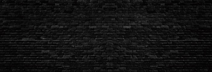 Poster Brick wall Wide old black shabby brick wall texture. Dark masonry panorama. Brickwork panoramic grunge background