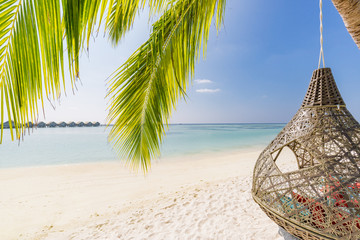 Chill lounge zone on the sandy beach, Maldives island. Beautiful tropical Maldives beach under...